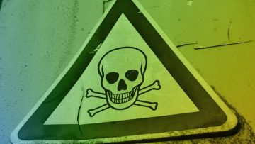 Sign alerting against toxins representing the 4 toxins of teamwork